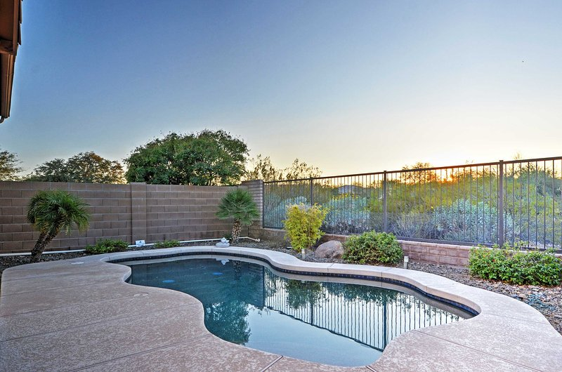 Dive into this 3-bedroom, 2.5-bathroom Peoria vacation rental house for up to 8!