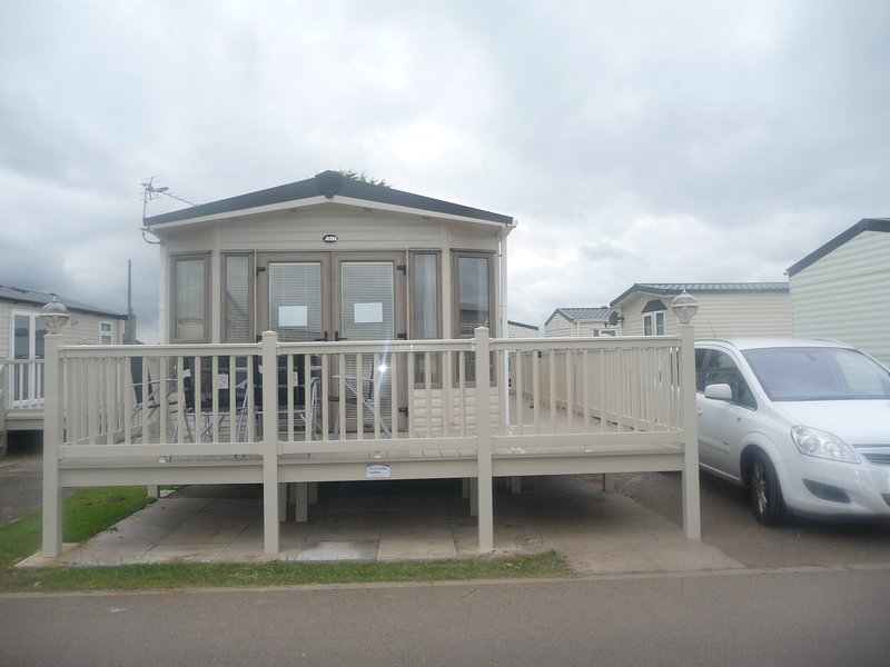 ABI Windermere Caravan with large veranda to front and side of caravan.  Private Parking Space.