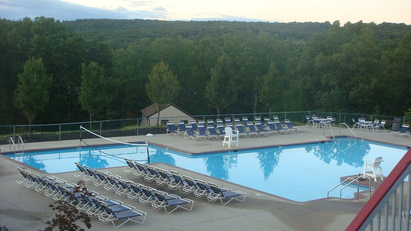 One of The Swimming Pool of the association adjacent to top of the World Restaurant & ski lift