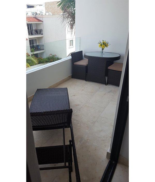 Enjoy morning coffee or evening cocktails on your private balcony
