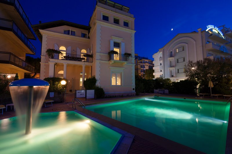 VILLA FIORITA night with pools view from the beach