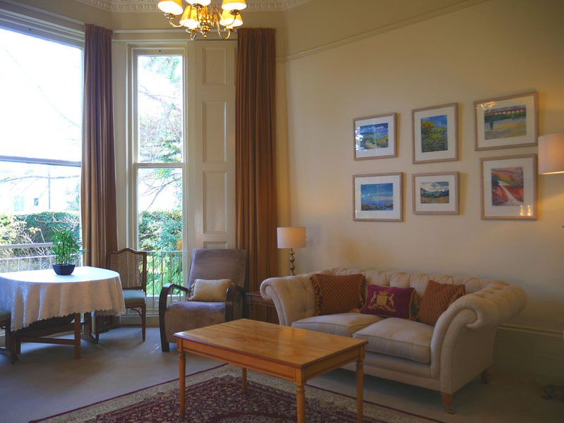 Apartment with large sitting room. It has massive bay window overlooking The Rose Garden