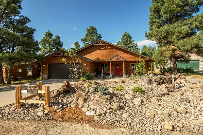 Nestled in the pines, rustic Woodsman Cottage is close to all amenities.