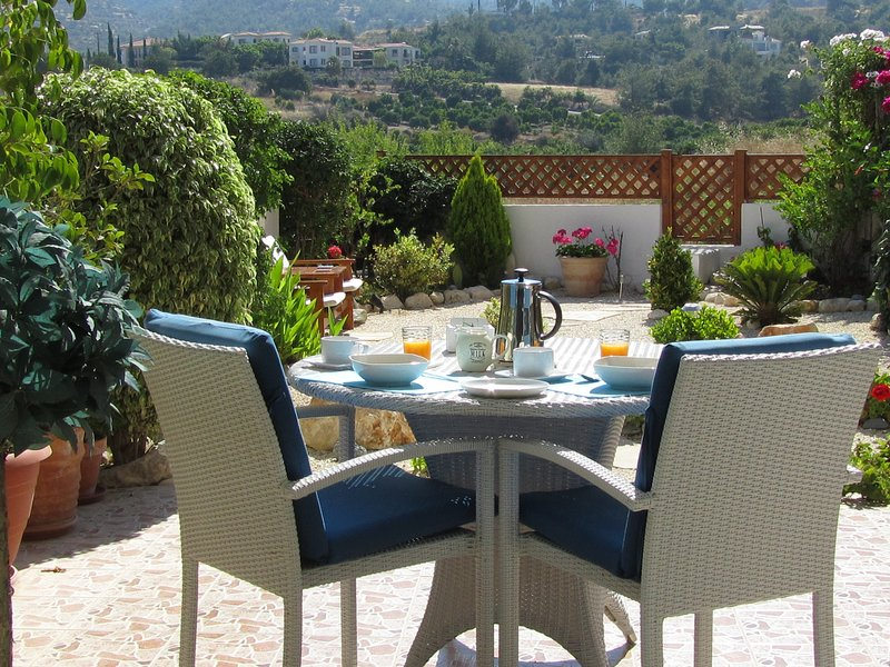 'Breakfast in the Sun' Attractive garden with assorted Mediterranean plants.