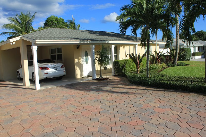 Plenty of parking with a lovely custom paver brick driveway