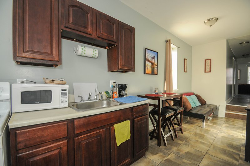 Eat in kitchen area fully stocked with all amenities.  Everything included to cook.