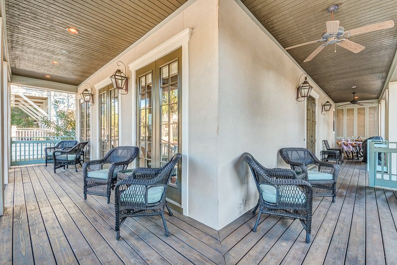 Wrap around 1st level covered porches w/ plenty of seating, ceiling fans, gas grill, 4 bikes