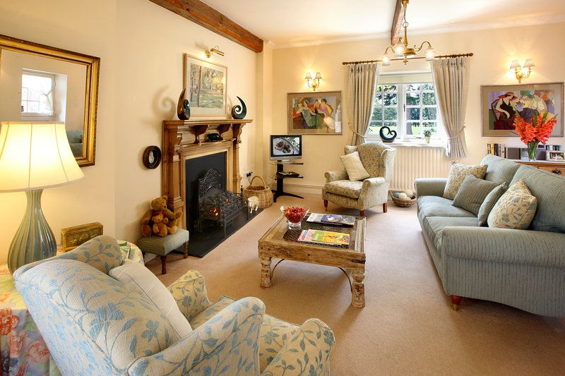 Spacious lounge with views over garden and parkland, door leading to walled courtyard garden