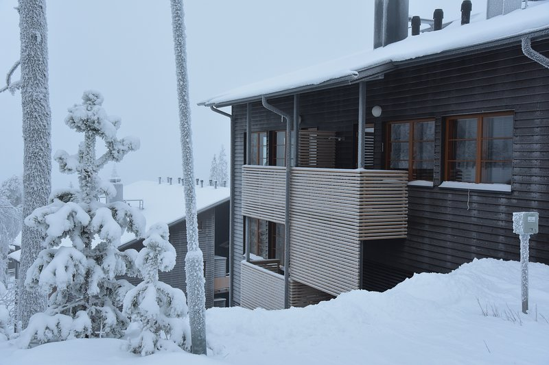 Lägenheten huset på vintern.