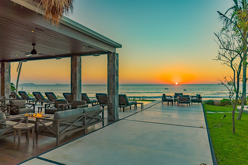 Poolside sunset on the Pacific Ocean.