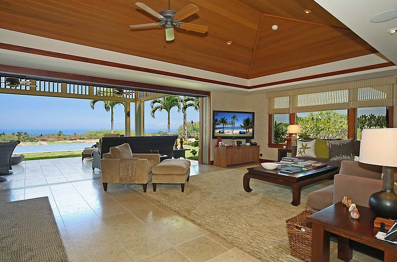Lounge room with indoor outdoor living and spectacular ocean views