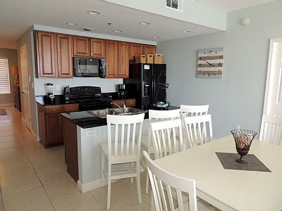 Fully stocked kitchen and dining area seats 9.
