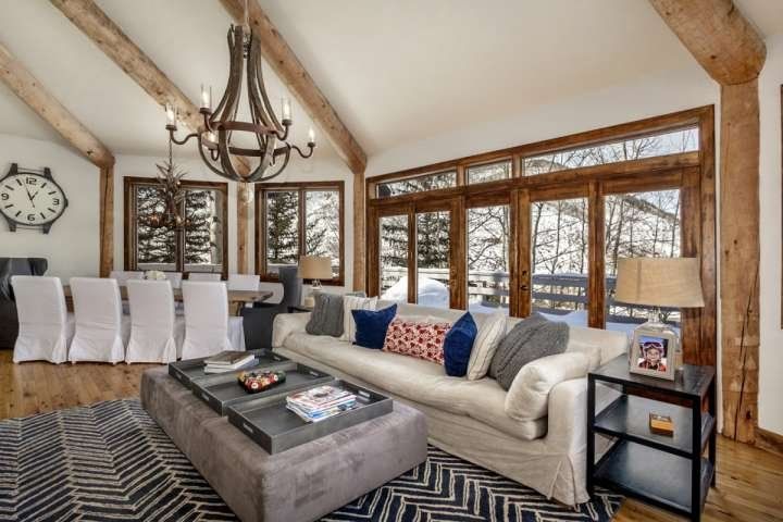 Spacious living and dining room with amazing north facing Vail Valley views.