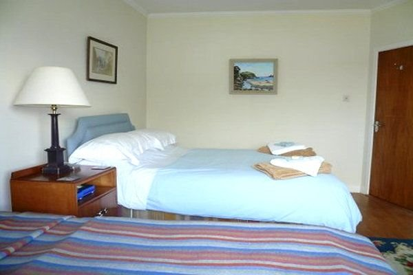 comfortable bedroom with sea view complete with linen and towels