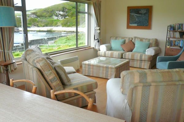 Living room with view of pier and harbour
