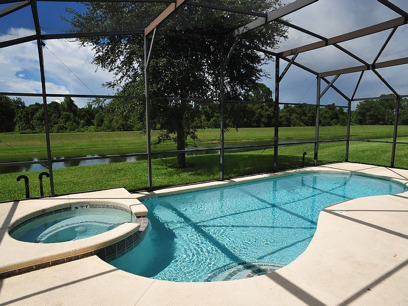 Private pool, back on retention pond and conservation land.