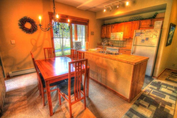 SkyRun Property - '1856 The Seasons' - Dining/Kitchen - There is plenty of room for 6 at this dining room table that can be expanded (shown) or contracted to fit your needs.  The kitchen is VERY well stocked and large.
