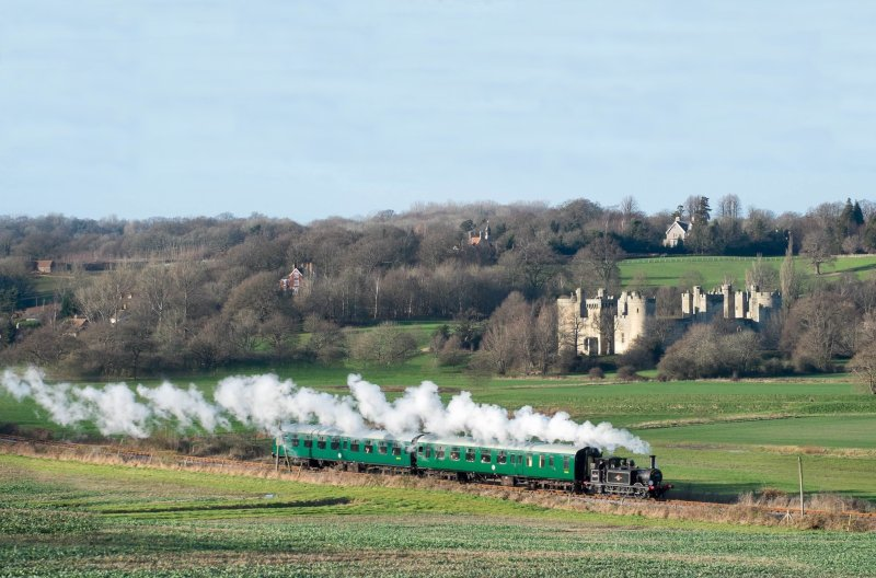 Locomotive leaving Bodiam station. View over the Castle. All this a 20 minute walk from the cottages