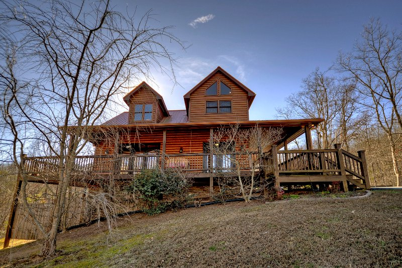 The lodge is surrounded with 1000 sq. ft. of wrap around porches & ample seating to enjoy views.