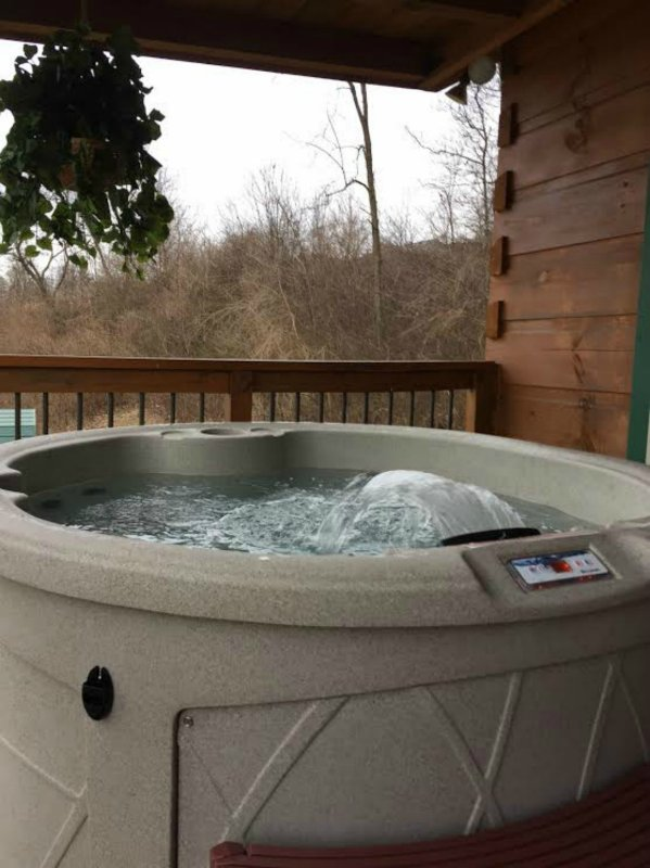hot tub with waterfall on the front deck