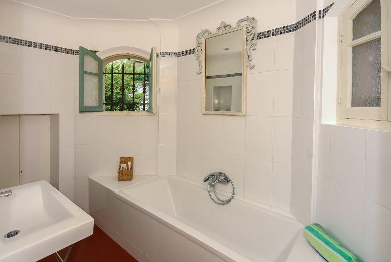 Pristine white bathroom .