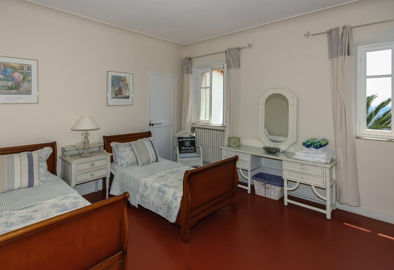 Fourth bedroom with twin beds and space for extra fold out small single bed if required .