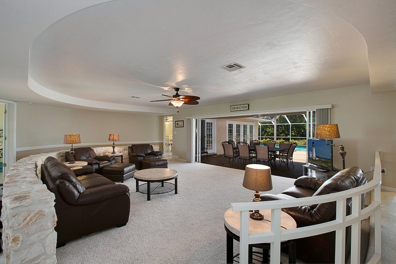 Family Room that opens to the Lanai and the Pool!