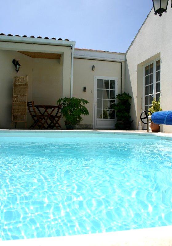Front door of studio, and pool