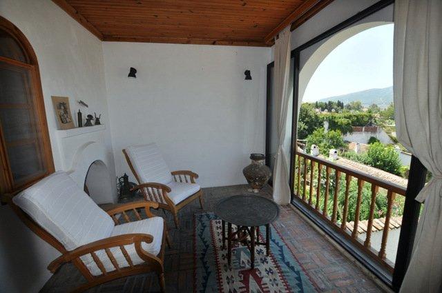El dormitorio principal sala de estar privada con vistas al templo de Artemisa