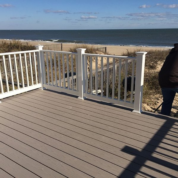 View the ocean from one of three decks. less than 150 feet of sand from the Atlantic.