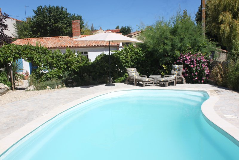 17th Century longere with heated pool. Tranquil setting near beaches.