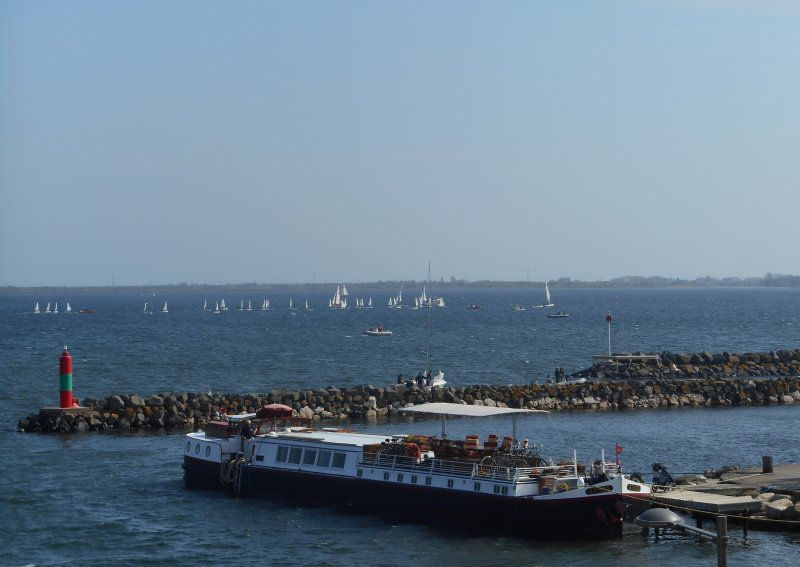 View of hotel barge and sailing boats from terrace