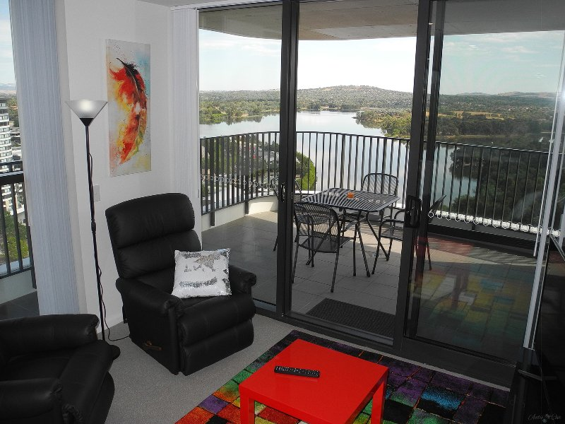 Modern and secure. Elevated stylish 3BR apartment with expansive lake and mountain views.