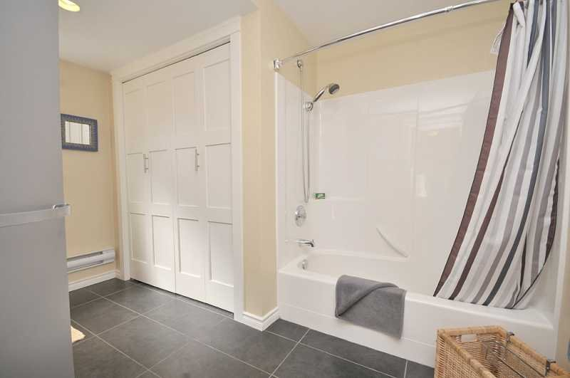 Full bathroom and laundry in upstairs bath