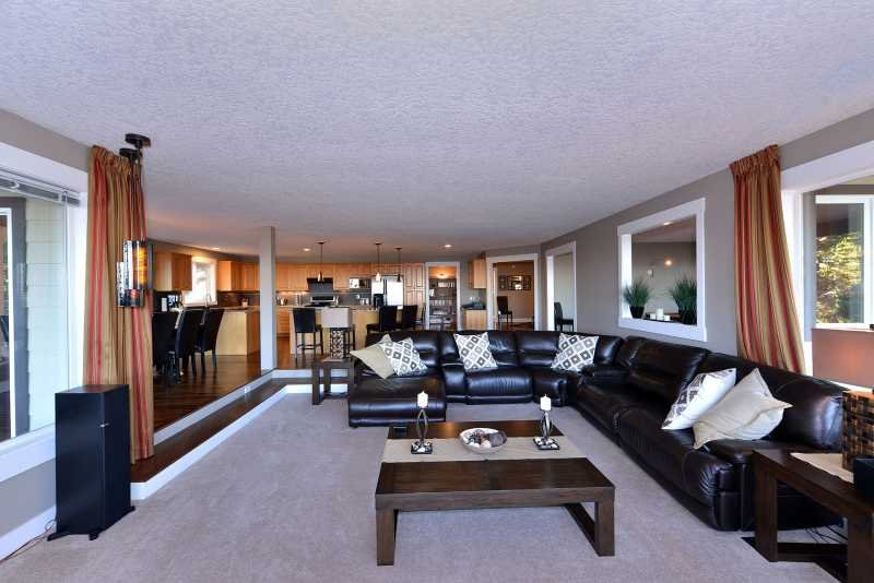 The formal living room with large sectional couch.