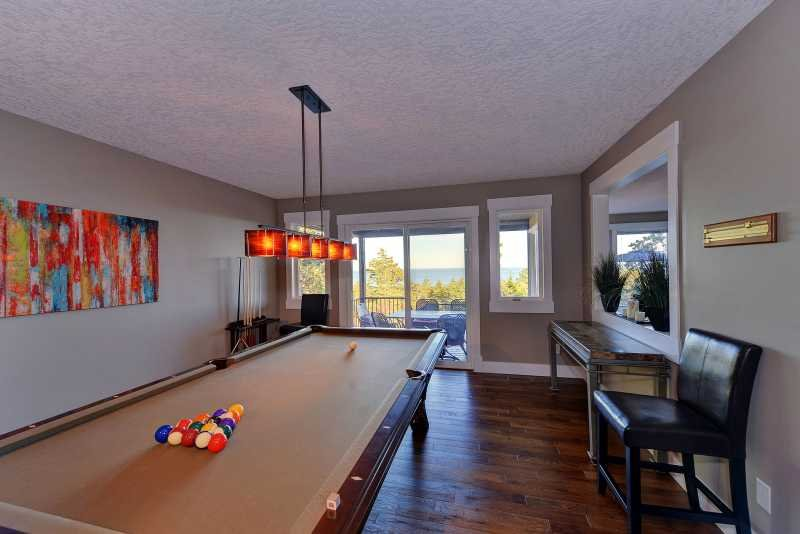 Large billiards room with access to the deck.