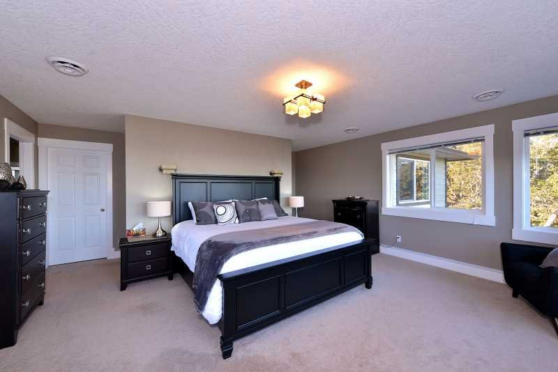 Massive master bedroom with king size bed.