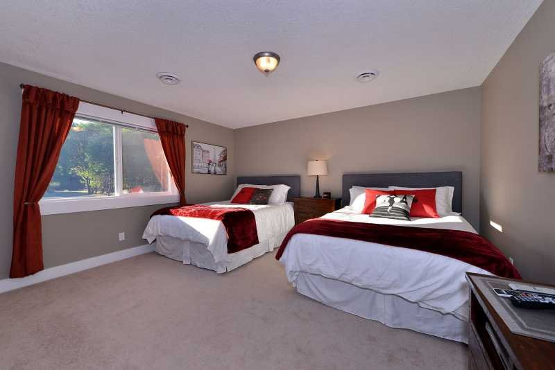 Third bedroom with two queen size beds.