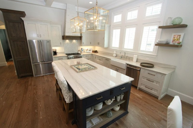 Kitchen has Pecky Cypress Cabinets