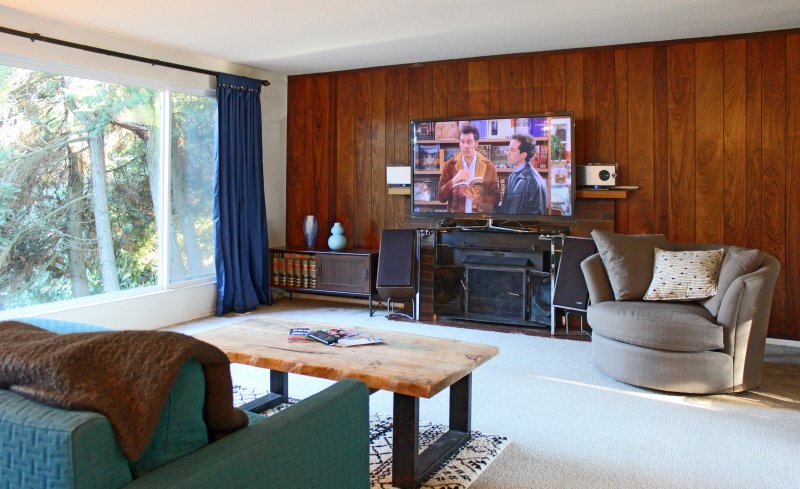 Living room features a Sharp stereo system, 64' plasma smart TV