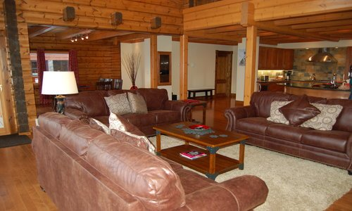 The Minks: Main floor is an open concept kitchen/living/dining room with gas fireplace .