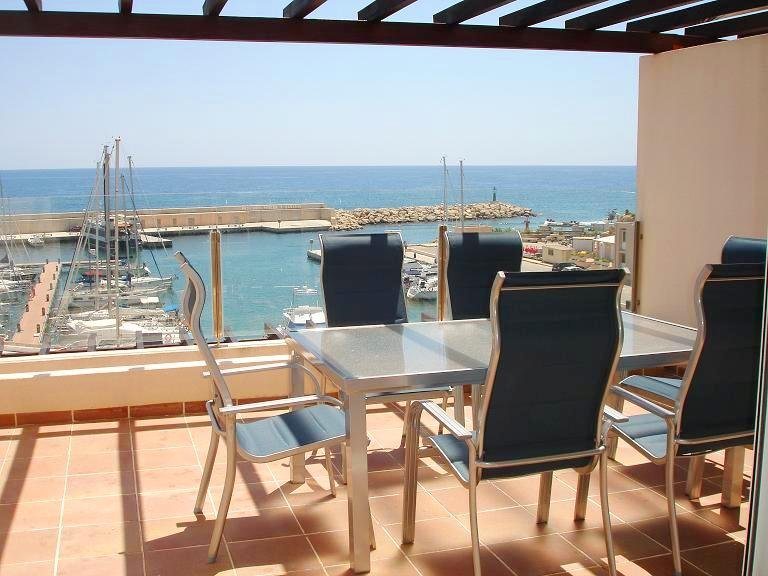 Terrace facing the sea and marina