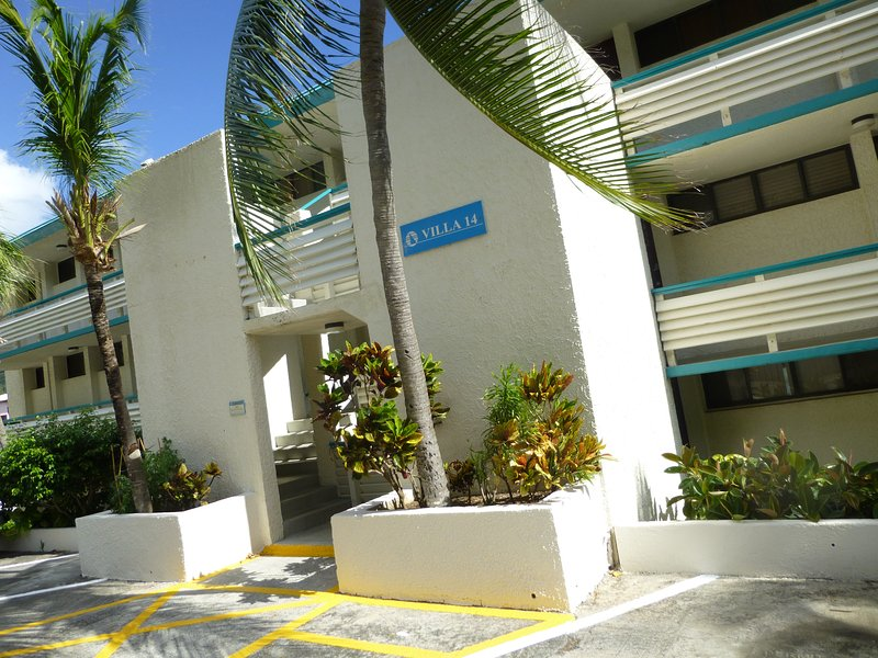 Entrance to building 14 with one parking space.