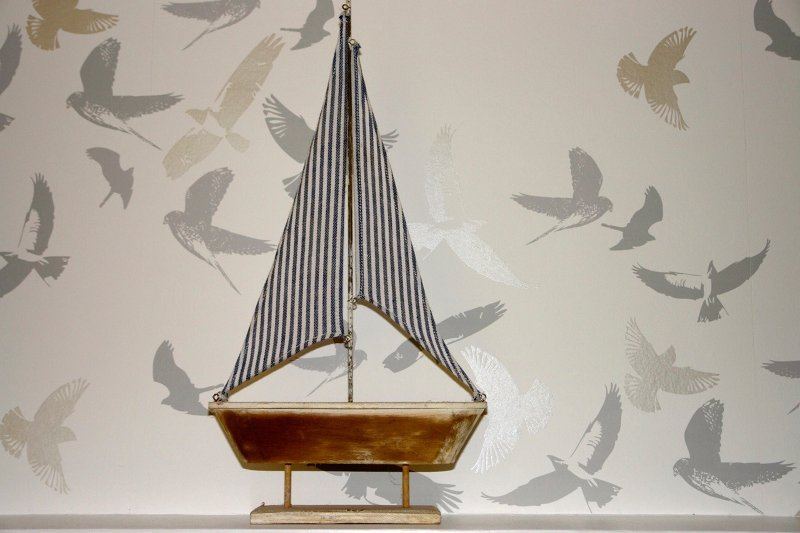 'Boat' on mantelpiece in bedroom.