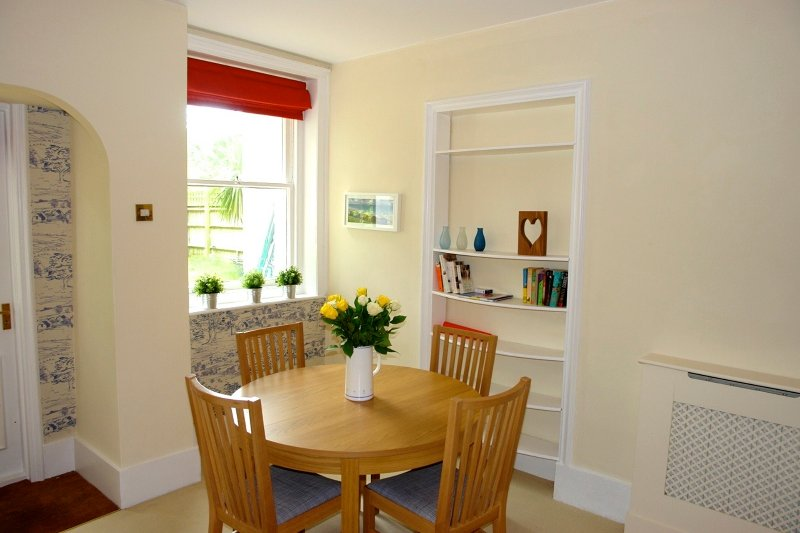 Dining Table extends to seat six.