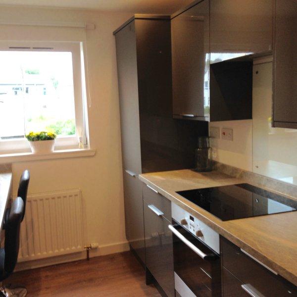 Bright fresh kitchen with dishwasher, fridge freezer, microwave, induction hob and single oven