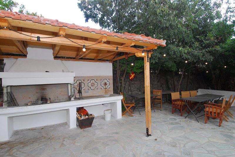 Communal BBQ and shady seating area