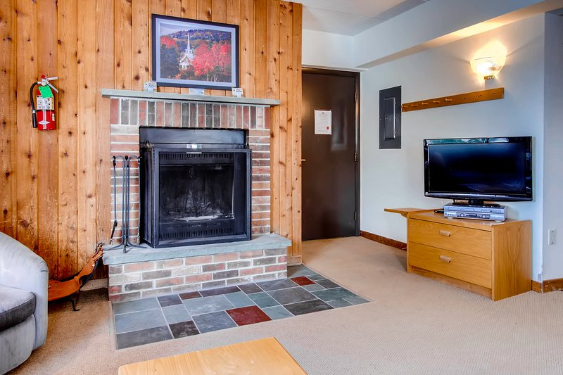 The living Room and fireplace w/ a flat screen TV