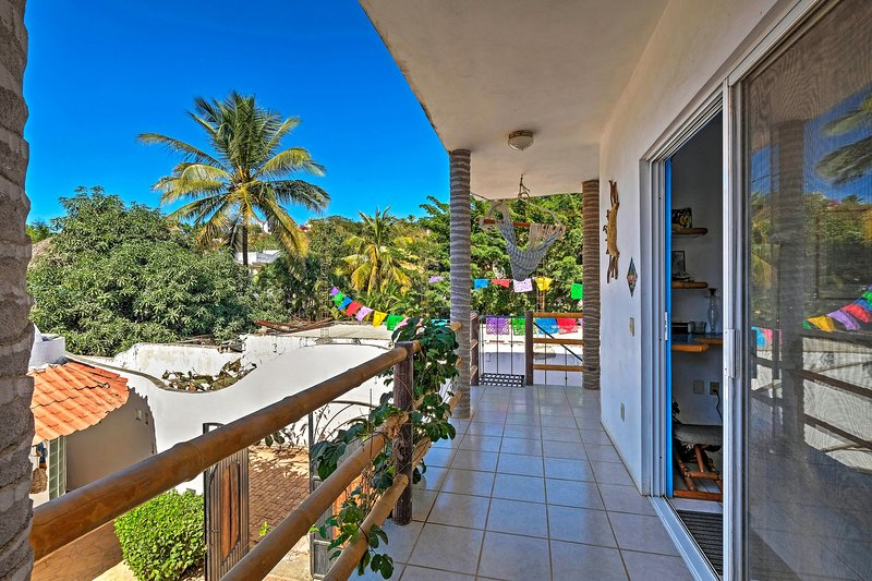 This 2BR, 1-bath vacation rental condo boasts jungle views and a great location.