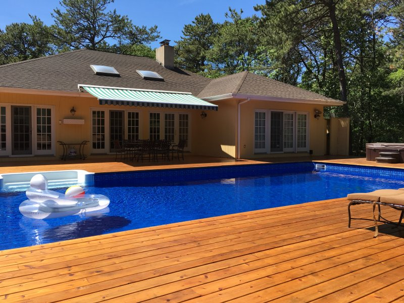 BRAND NEW CEDAR DECK AND POOL LINER (hot tub in background)